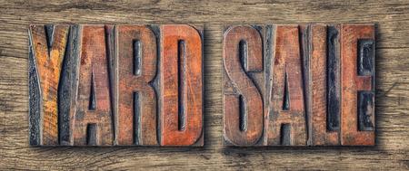 yard: Antique letterpress wood type printing blocks - Yard Sale Stock Photo