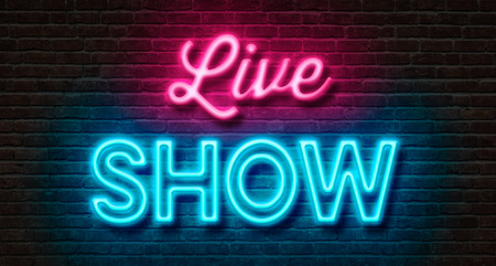 live entertainment: Neon sign on a brick wall - Live Show Stock Photo