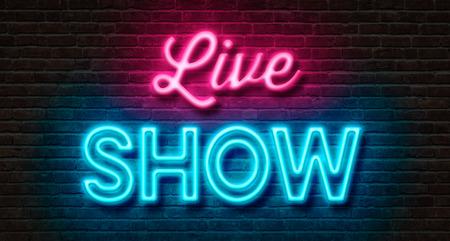Neon teken op een bakstenen muur - Live Show Stockfoto