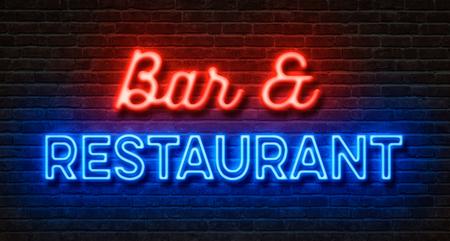 Neonový nápis na cihlové zdi - Bar a restaurace