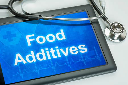 food additives: Tablet with the text Food Additives on the display Stock Photo