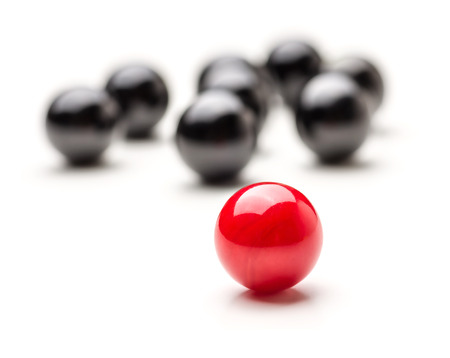 lonliness: Concept with red and black marbles - Teamleader