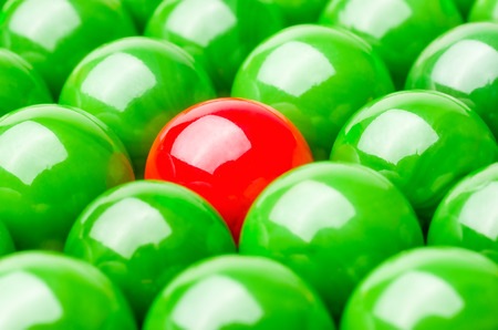 closed society: Concept with red and green marbles -  Being different