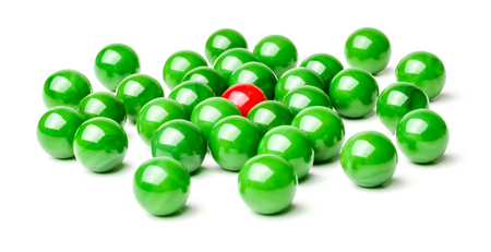 lonliness: Concept with red and green marbles -  Harassment