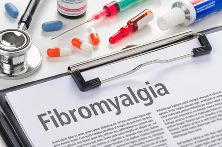 The diagnosis Fibromyalgia written on a clipboard 스톡 콘텐츠