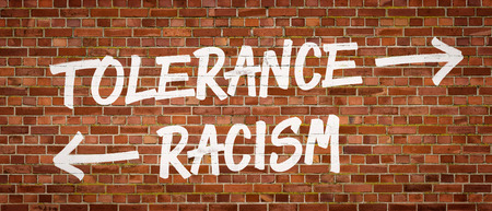 tolerance: Tolerance or Racism written on a brick wall Stock Photo