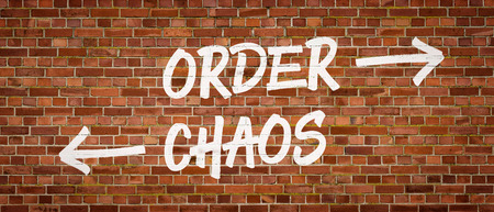 chaos order: Order or Chaos written on a brick wall