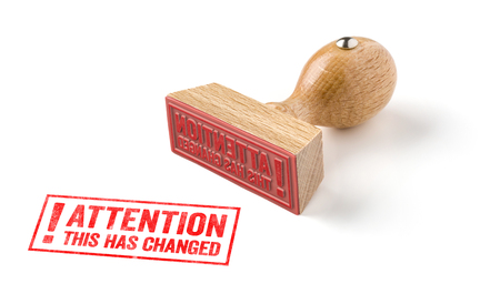 directive: A rubber stamp on a white background - Attention this has changed