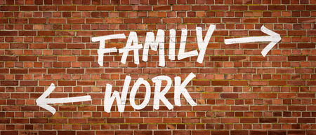 union familiar: Family or Work written on a brick wall