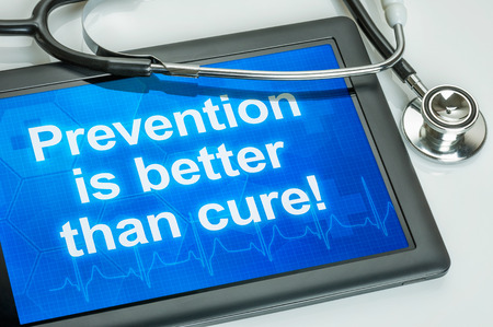 cure prevention: Tablet with the text Prevention is better than cure