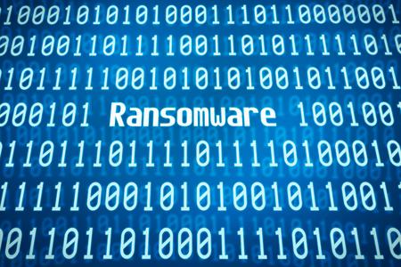 Binární kód se slovem Ransomware ve středu