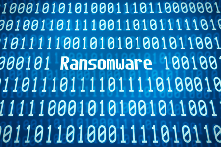 Binary code with the word Ransomware in the center
