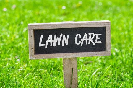 Sign on a green lawn - Lawn care Stock Photo