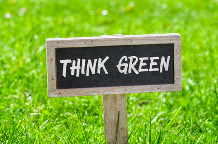 Sign on a green lawn - Think green