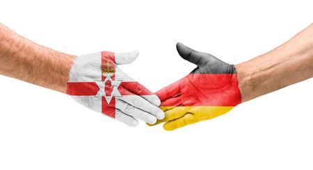 northern ireland: Football teams - Handshake between Northern Ireland and Germany