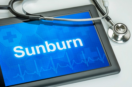 sunburn: Tablet with the diagnosis Sunburn on the display