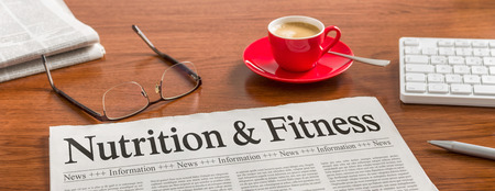 articles: A newspaper on a wooden desk - Nutrition and Fitness