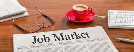 job market: A newspaper on a wooden desk - Job Market Stock Photo