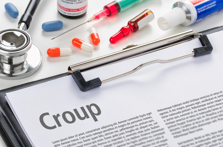 ointment: The diagnosis Croup written on a clipboard