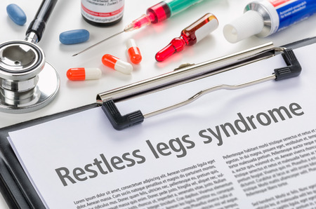 The diagnosis Restless legs syndrome written on a clipboard 스톡 콘텐츠