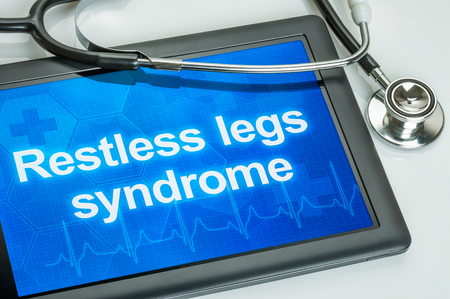 restless: Tablet with the diagnosis Restless legs syndrome on the display