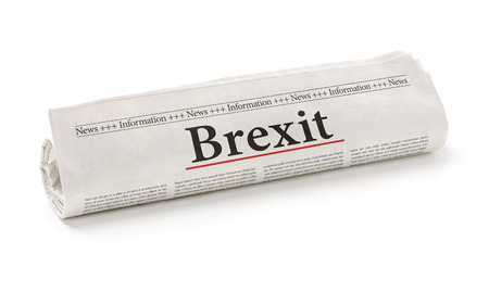 headline: Rolled newspaper with the headline Brexit Stock Photo
