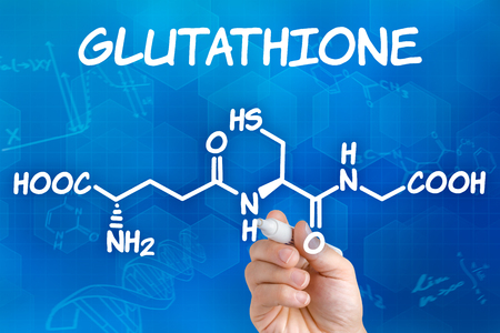 free radicals: Hand with pen drawing the chemical formula of Glutathione Stock Photo