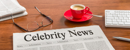 prominence: A newspaper on a wooden desk - Celebrity News