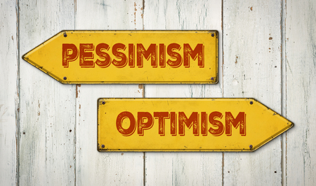 pessimism: Direction signs on a wooden wall - Pessimism or Optimism