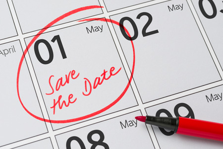 Save the Date written on a calendar - May 1 Foto de archivo