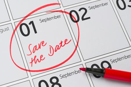 Save the Date written on a calendar - September 1 Imagens