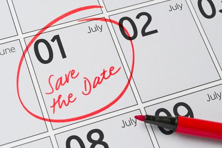 calendario julio: Save the Date written on a calendar - July 1 Foto de archivo