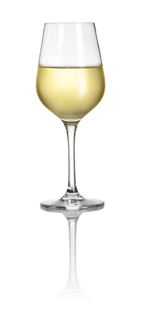 Glass filled with white wine on a white background