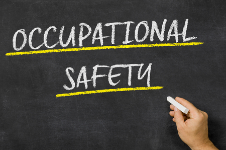 safety slogan: Occupational safety written on a blackboard Stock Photo