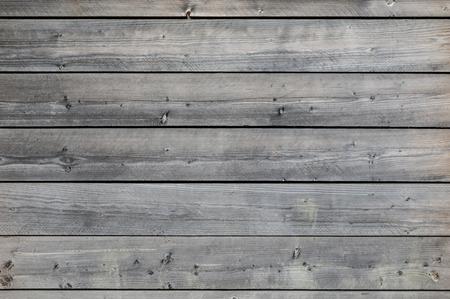 Zvětralé šedé dřevěné pozadí Reklamní fotografie