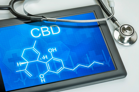Tablet with the chemical formula of CBD Stock Photo - 61890456