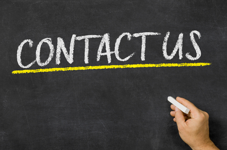 adress: Contact us written on a blackboard Stock Photo