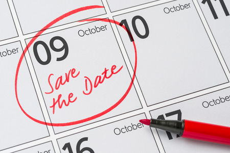 9 months: Save the Date written on a calendar - October 9