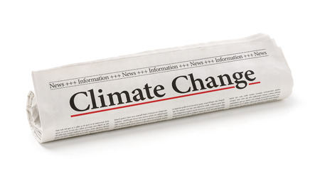 carbon emission: Rolled newspaper with the headline Climate change Stock Photo