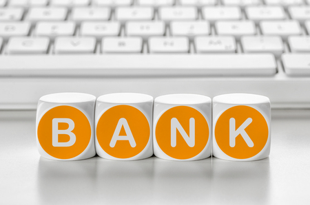 Letter dice in front of a keyboard - Bank Stock Photo