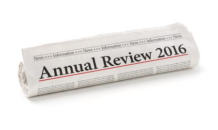 giornale arrotolato con il titolo Annual Review 2016 Archivio Fotografico