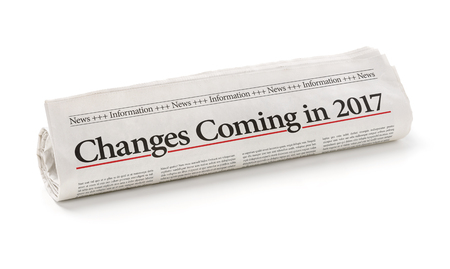 turn of the year: Rolled newspaper with the headline Changes coming in 2017