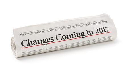 Rolled Zeitung mit der Schlagzeile Änderungen im Jahr 2017 kommen Standard-Bild - 63927002