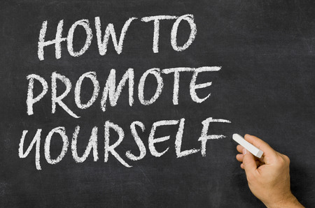sell: How to promote yourself written on a blackboard Stock Photo