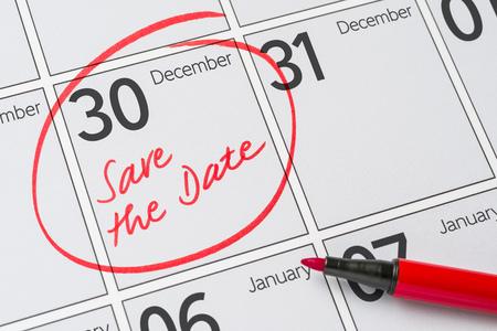 calendario diciembre: Save the Date written on a calendar - December 30
