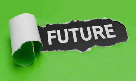 Torn green paper revealing the word Future