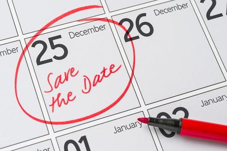 calendar date: Save the Date written on a calendar - December 25