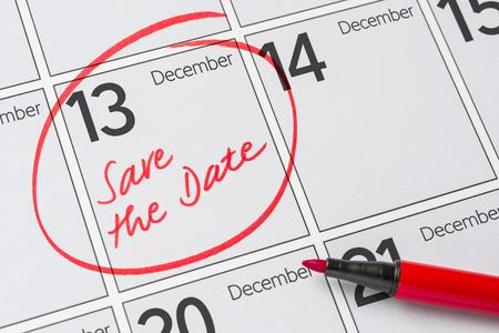 calendario diciembre: Save the Date written on a calendar - December 13 Foto de archivo