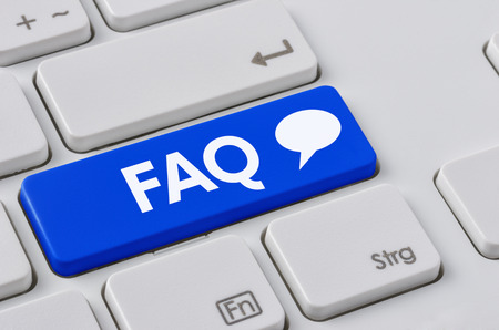 A keyboard with a blue button - FAQ