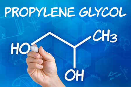 glycol: Hand with pen drawing the chemical formula of Propylene glycol